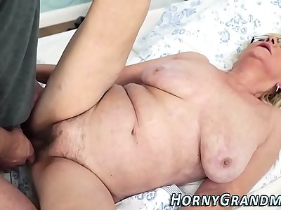 Fingered granny takes cum